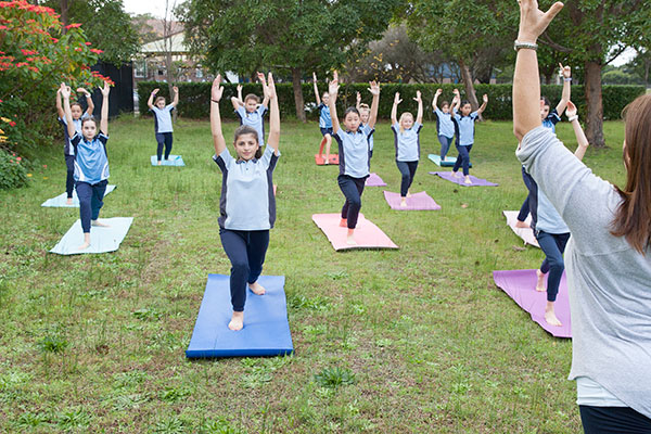 Students at St Michael's Catholic Primary School being taught yoga