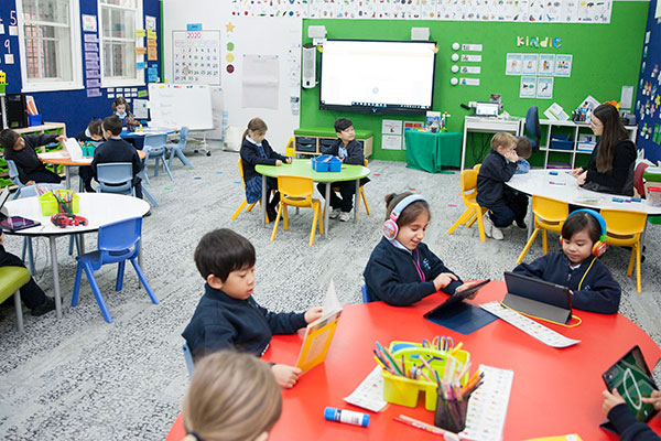 Students using technology in modern classroom at St Michael's Catholic Primary School Daceyville