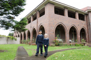 Two St Michael's Catholic Primary School Daceyville walking in the courtyard of Our Lady of The Sacred Heart convent