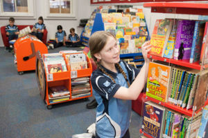 Students reading books at St Michael's Catholic Primary School Daceyville library