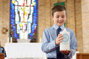 Student inside of church holding the St MIchael's Catholic Primary School Daceyville candle