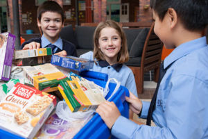 Students at St Michae;'s Catholic Primary School Daceyville packing hamper for donation to local charity
